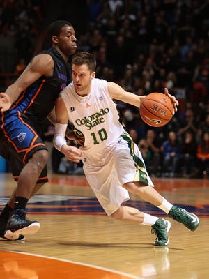CSU's Wes Eikmeier drives past Boise State's Derrick Marks during a March 2, 2013, game in Boise, Idaho. Eikmeier is joining the staff of his former CSU coach, Tim Miles, as a graduate assistant at Nebraska.