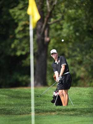 Massillon's Nate Albrecht hits onto the 11th green at The Elms on Thursday during a match against Fairless. Sept. 10, 2020.