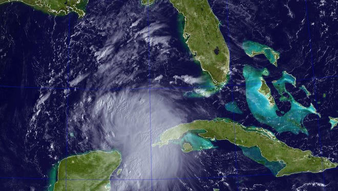 This satellite image obtained from the US Naval Research Laboratory (NRL) shows Tropical Storm Karen crossing the Yucatan Strait on October 3, 2013.
