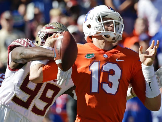 FSU's Brian Burns strips the ball against Florida.