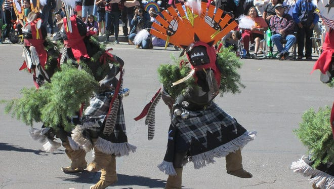 Crown dancers from the White Mountain Apache Tribe perform at the annual Apache Jii Festival.