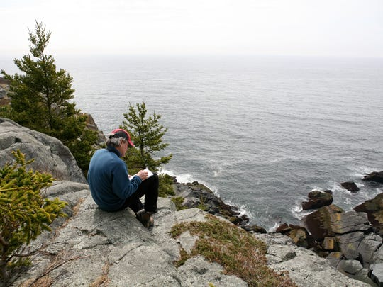 Peter Sculthorpe works on sketches on Monhegan Island, Maine, that he will take back to his studio to create paintings.