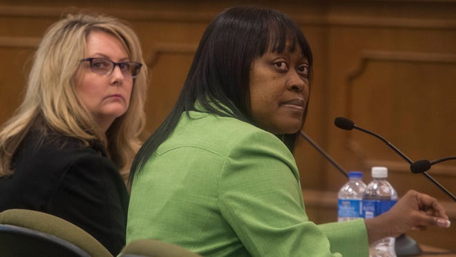 Former Department of Human Services Commissioner Raquel Hatter, right, has faced questions from lawmakers over the agency's operation of a food service program.