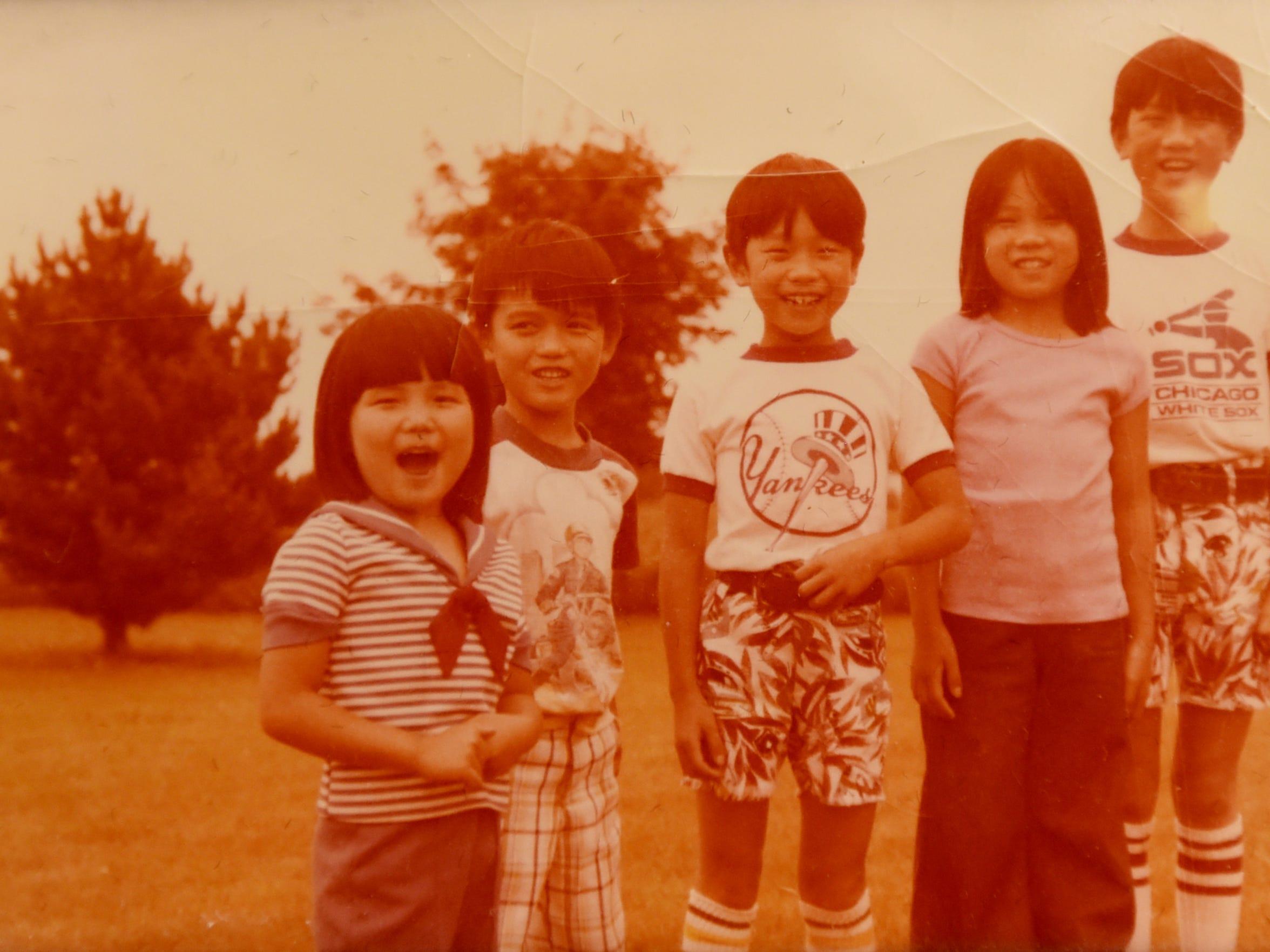 Hang (Hanna) Thi Hoang and siblings in a family photo.