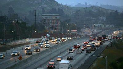 Morning rush hour traffic moves along Highway 60 near Riverside.