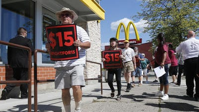 Supporters of a $15 minimum wage for fast-food workers rally in front of a McDonald's in Albany on July 22.