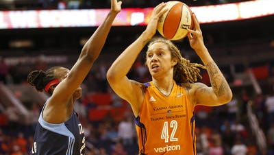 Forward Sancho Lyttle, left, signed with the Phoenix Mercury as a free agent and will team with Brittney Griner, right, in 2018.