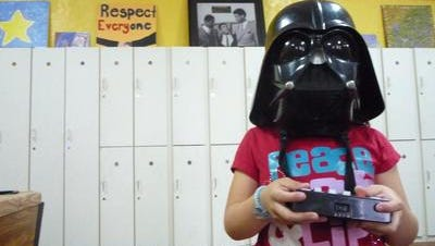 Kiara Morales, 7, wears a Darth Vader mask during her after-school program at the Don Bosco Community Center in Port Chester May 24, 2012. The center had to cut back its after-school hours after a holdup in federal community development funds -- a result of the dispute over the Westchester County affordable housing settlement.