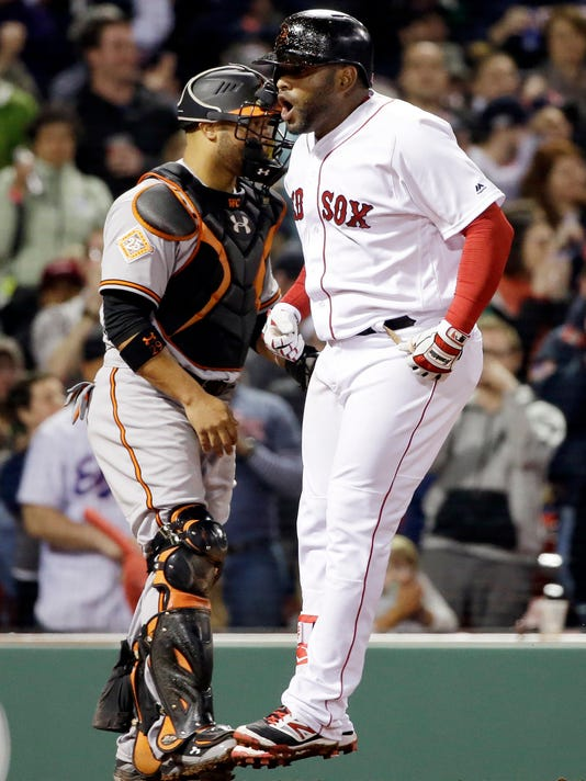 Boston Red Sox's Pablo Sandoval jumps as he crosses home plate in front of Baltimore Orioles catcher Welington Castillo after hitting a two-run home run during the fourth inning of a baseball game at Fenway Park, Wednesday, April 12, 2017, in Boston. (AP Photo/Elise Amendola)