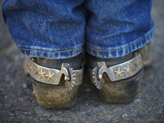 Cowboy boots with spurs.