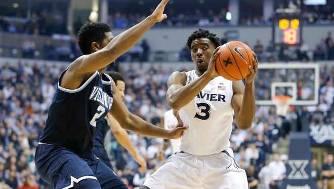 Xavier Musketeers guard Quentin Goodin (3) gets pressured by Villanova Wildcats forward Kris Jenkins (2) in the first half.