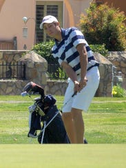 Senior Ezra Uzueta chipped onto the green during Thursday's