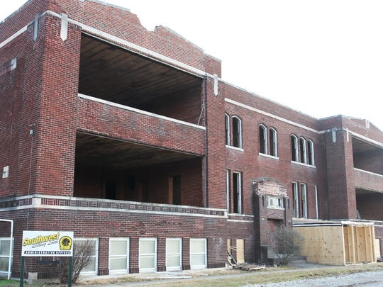 Demolition crews are in the process of tearing down the former Etna School.