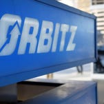 This Feb. 12, 2015 file photo shows signage for travel booking site Orbitz outside the building that houses its headquarters, in Chicago.