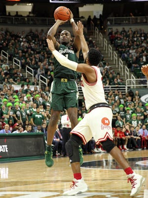 Michigan State freshman guard Joshua Langford shoots over Nebraska center Jordy Tshimanga during the second half Thursday night at Breslin. Langford finished with a career-high 17 points.