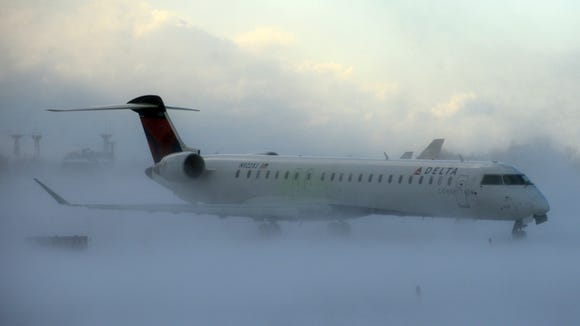 A Delta Connection regional jet negotiated its way