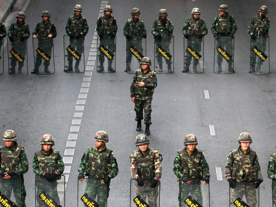 In this May 29, 2014 file photo, Thai soldiers form