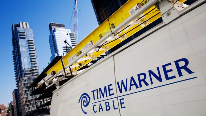 FILE - In this Feb. 2, 2009 file photo, a Time Warner Cable truck is parked in New York. Time Warner Cable said its 2014 fourth quarter net income rose as it added more Internet customers but saw the number of TV customers drop. (AP Photo/Mark Lennihan, File) ORG XMIT: NY124
