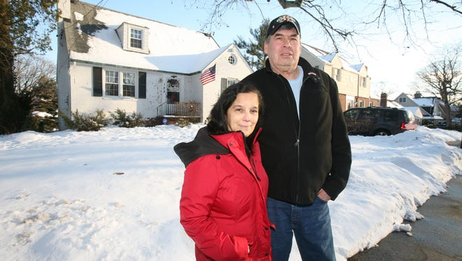 Vietnam veteran Ed Dingee is pictured with his wife Pam at their home in Yonkers, Jan. 30, 2015. They purchased the home in October 2014 and will qualify for various tax breaks.