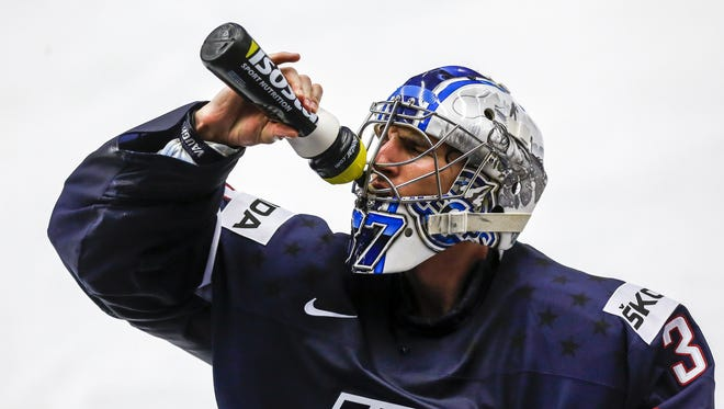 Commerce Township's Connor Hellebuyck, goalie for the United States, refreshes himself during the IIHF World Championship match against Slovakia on Tuesday, May 12, 2015, in Ostrava, Czech Republic.