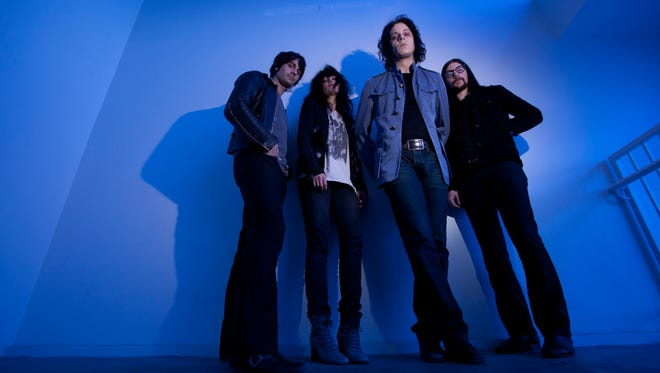 Members of the band The Dead Weather, from left, Dean Fertita, Alison Mosshart, Jack White, and Jack Lawrence pose at the House of Blues in Houston.