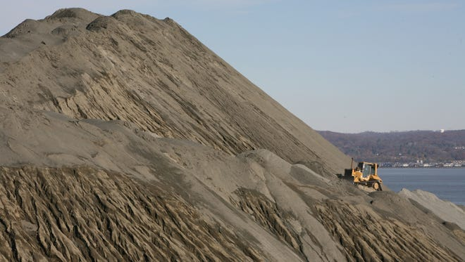 An bulldozer is dwarfed by a mountain of crushed rock as it works along the pile at the Tilcon plant off Route 9W in Haverstraw. The photo was taken November 2014.