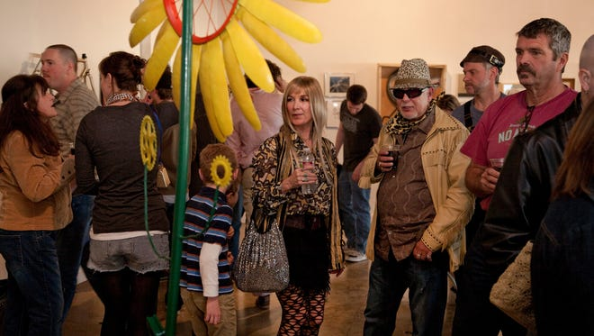 """A flower made from a bike wheel is on display during Reno Bike Project's """"We HeArt Bikes"""" art show fundraiser last year."""