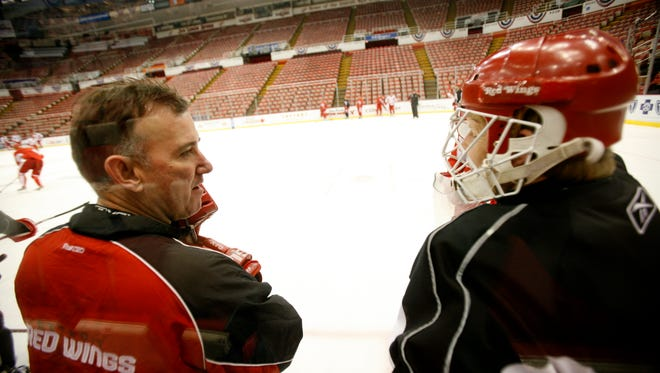 Jim Bedard, left, had been the Red Wings goaltending coach for the last 18 seasons.