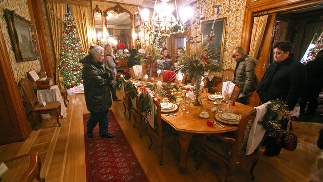 A tour group examines the formal dining room at the Pabst Mansion.