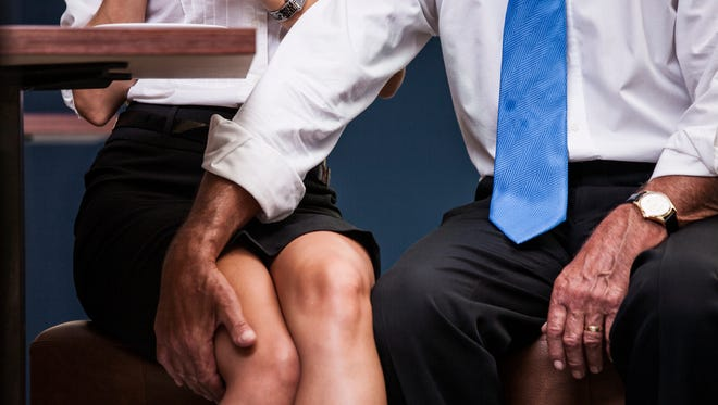 Senior businessman puting his arm on his coworker's knee.