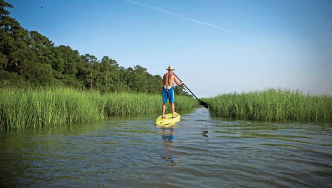Meader on a paddleboard on the May River, in South Carolina's small but spectacular Bluffton.