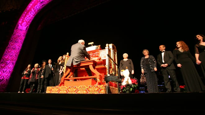 The Mighty Wurlitzer accompanies the choir for Keyboards at Christmas, a benefit for Mission of Hope.