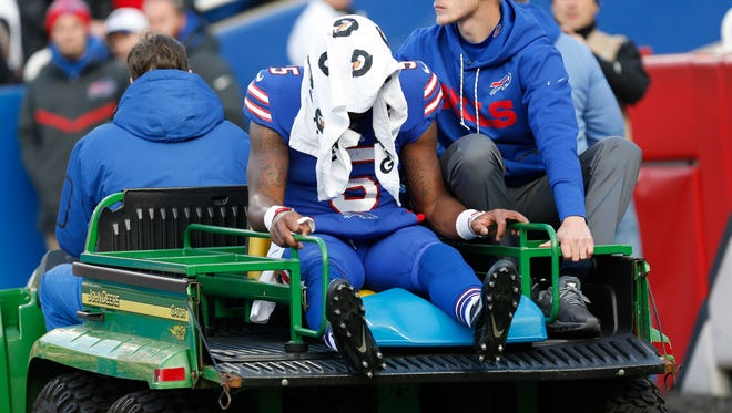 Dec 3, 2017; Orchard Park, NY, USA; Buffalo Bills quarterback Tyrod Taylor (5) gets taken off the field with an injury during the fourth quarter against the New England Patriots at New Era Field.  Mandatory Credit: Timothy T. Ludwig-USA TODAY Sports