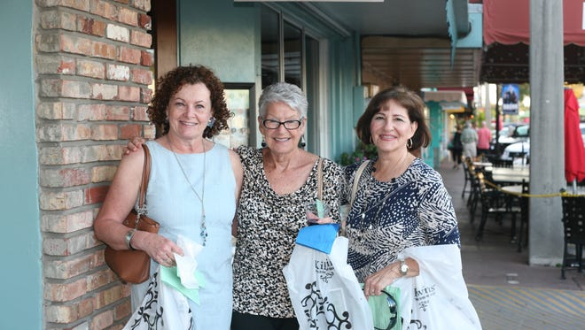Shoppers enjoy an evening downtown at the Spring Stuart Stroll.