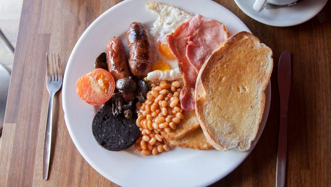 A traditional Irish (and English) breakfast includes bacon, sausage, black or white pudding, beans, eggs, tomatoes and bread - or any combination of these.
