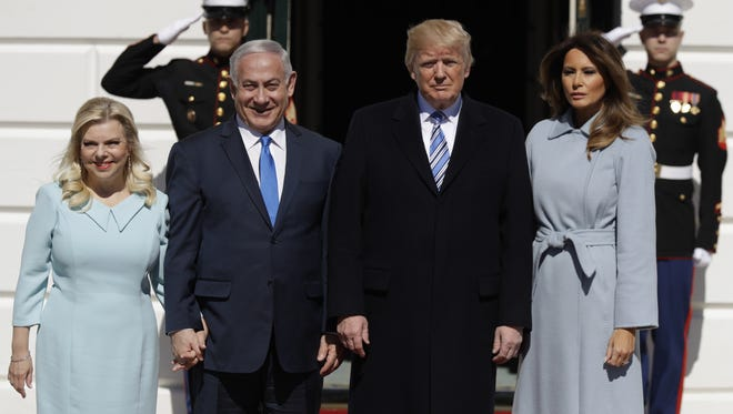 President Trump and first lady Melania Trump meet with Israeli Prime Minister Benjamin Netanyahu and his wife Sara Netanyahu as they arrive at the White House.