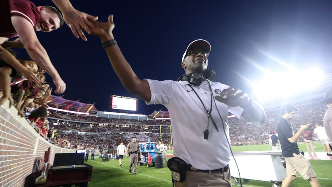 FSU Head Coach Willie Taggart high-fives fans during the Seminoles' Garnet and Gold Spring Game at Doak Campbell Stadium on Saturday, April 14, 2018