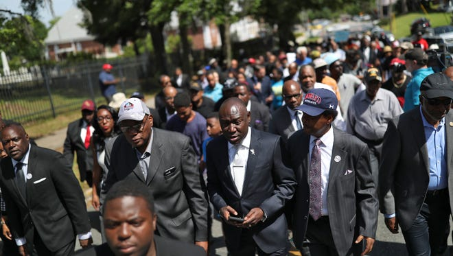 Rev, R.B. Holmes, from front left, Attorney Ben Crump and County Commissioner Bill Proctor joined a few hundred marchers in Tallahassee Thursday to support the restoration of voting rights for felons in the state of Florida. The demonstration was held in support of Amendment 4, representing a restoration of civil and voting rights to the 1.6 million felons who are currently denied those rights in the state.
