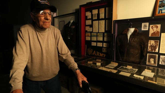 Sammy Esposito, 96, a World War II Army veteran stands amongst a display at Camp Gordon Johnston Museum in Carrabelle, which officially opened its doors to visitors this month.