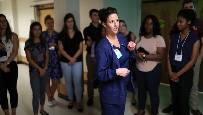 Rita Sekula, a nurse at Capital Regional Medical Center's Gadsden Memorial Campus, shows first-year FSU medical students around their facility on Friday, June 1, 2018. The trip was scheduled by the university to introduce the young, aspiring doctors to regional rural healthcare systems.