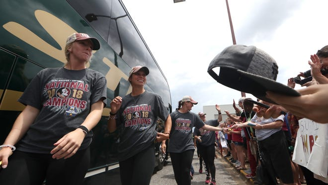 Fans greet the NCAA Softball World Series Champion Seminoles as they return home Wednesday from their sweep over Washington in Oklahoma City.