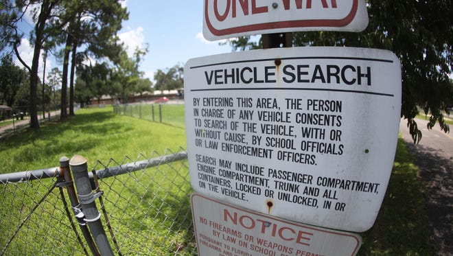 A sign notifying drivers that they are giving up their right to deny a search of their vehicle, with or without cause, is posted outside of Sabal Palm Elementary School. After a dust up on social media, they are coming down across the Leon County School district.