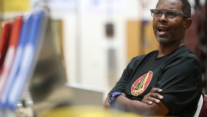 Former Washington Wildcats football coach Charlie Ward, now basketball coach at Florida High in Tallahassee, watches his team in a summer league game on June 19 in Tallahassee.