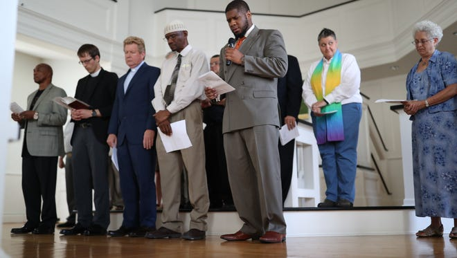Faith leaders from around the city gather at  First Presbyterian Church, coinciding with  World Refugee Day, to admonish current U.S. administration immigration policies in a prayer service on Wednesday, June 20, 2018.