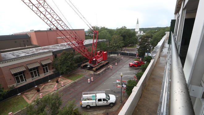 Construction continues with North Adams Street remaining closed outside of the DoubleTree hotel downtown Thursday, June 14, 2018.