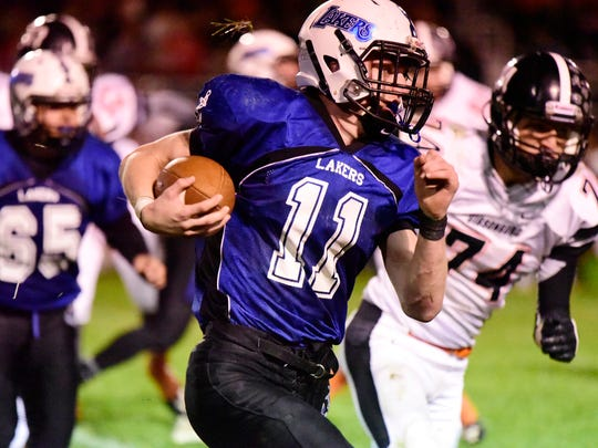 Danbury's Jared Koenig carries the football.