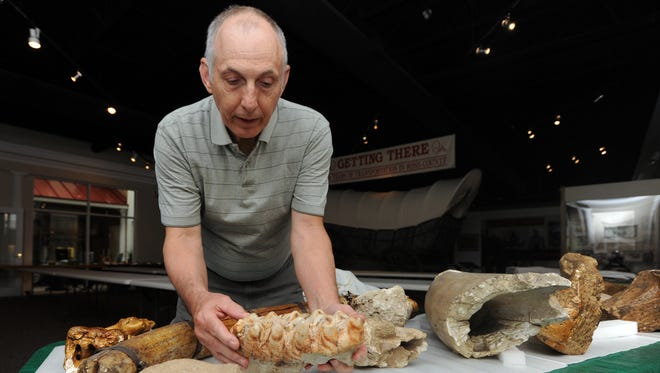Gary Argabright, vice president of the Mound City chapter of the Archaeological Society of Ohio, holds up a mastodon tooth Thursday, April 21, 2016, at the Ross County Historical Society.