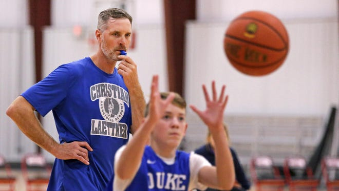 Former Duke University and NBA standout Christian Laettner keeps a watchful eye on a camper during his basketball camp at Lake Park Sportzone in Town of Harrison in 2016.