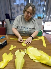 Jo Ellen McCracken, a volunteer at for Alliance for Suicide Prevention, makes ribbons for No Shame November, a series of awareness and fundraising events to encourage positive discussion of mental health issues and suicide prevention.