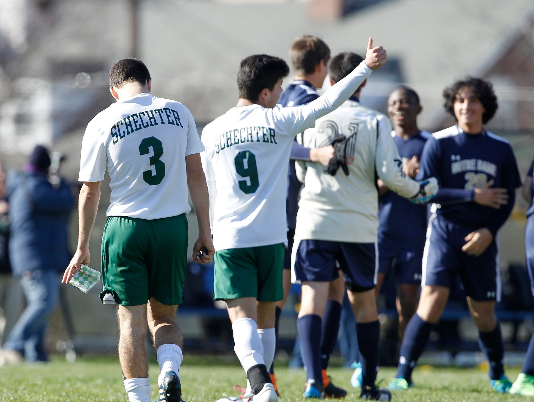"""Solomon Schechter's Miles Ogihara (9) gives a """"thumbs up"""" to the fans after their 9-1 loss to Notre Dame in the NYSPHSAA boys class C soccer final at Middletown High School on Sunday, Nov. 15, 2015."""